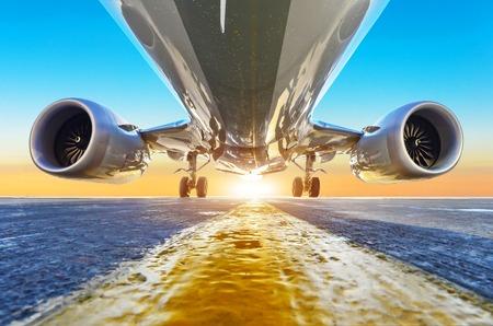 Foto de Passenger airplane is parked, view from below with bright light - Imagen libre de derechos