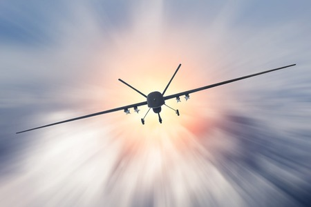 Foto de Unmanned military drone uav flying at high speed in the clouds. - Imagen libre de derechos