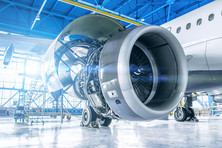 Photo pour Industrial theme view. Repair and maintenance of aircraft engine on the wing of the aircraft - image libre de droit