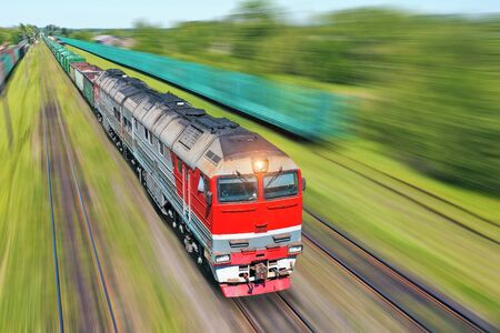 Foto de Freight train going in a hurry along the train at high speed. Railway Transport Concept - Imagen libre de derechos