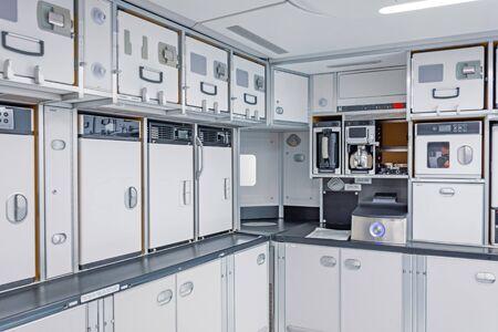 Photo pour Preparing food for the passengers in the empty kitchen corner inside airplane - image libre de droit