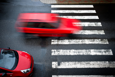 Photo for two red cars on the pedestrian crossing, - Royalty Free Image