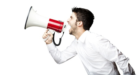 Photo for portrait of young man handsome shouting using megaphone over black background - Royalty Free Image