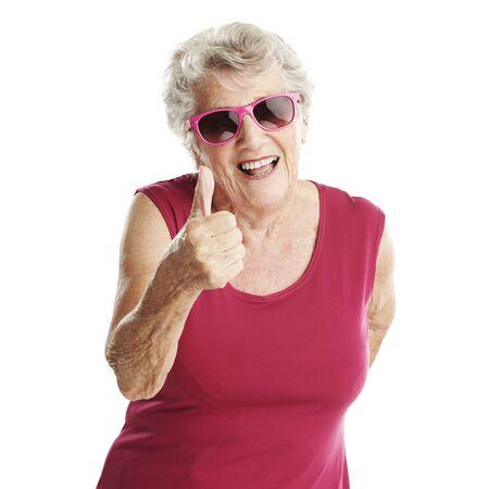 Photo pour portrait of senior woman approve gesture against a white background - image libre de droit