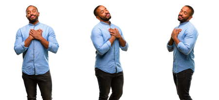 Photo for African american man with beard with hands in heart, expressing love and health concept - Royalty Free Image
