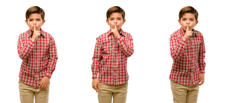 Photo for Handsome toddler child with green eyes with index finger on lips, ask to be quiet. Silence and secret concept - Royalty Free Image