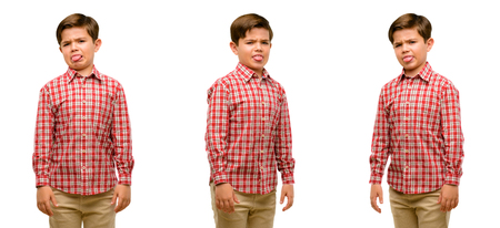 Photo pour Handsome toddler child with green eyes feeling disgusted with tongue out - image libre de droit