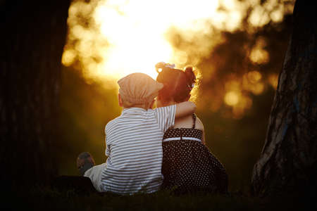 Photo for boy and girl on sunset - Royalty Free Image