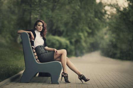 Foto für young beautiful girl sitting on bench in park - Lizenzfreies Bild