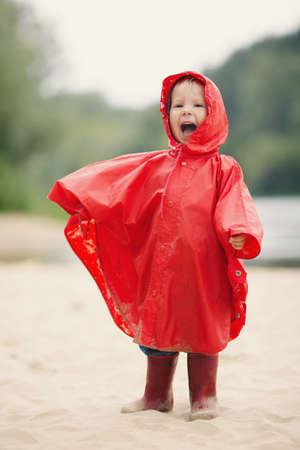 little funny girl with raincoat