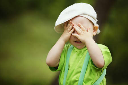 Photo for little funny boy plays hide and seek - Royalty Free Image