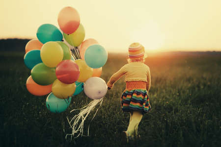 Foto de little girl with colorful balloons - Imagen libre de derechos