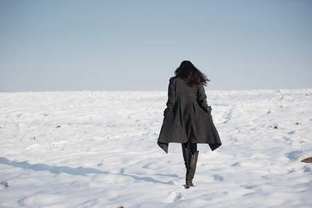 Foto per beautiful girl alone in winter field - Immagine Royalty Free