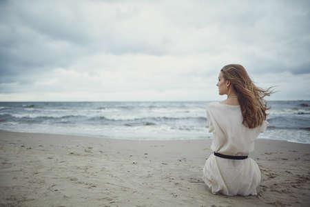 Foto de beautiful alone sensual girl on the beach - Imagen libre de derechos