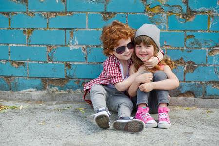 Foto de photo of two happy cute hipsters on the street - Imagen libre de derechos