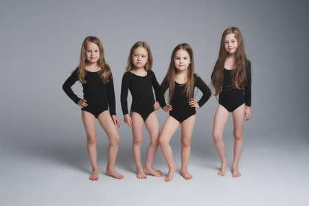 Foto de four young beautiful models on grey - Imagen libre de derechos