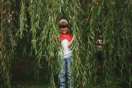 Photo for little girl hiding in the willow foliage - Royalty Free Image