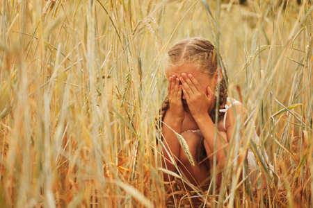 Photo for young girl in the yellow field - Royalty Free Image