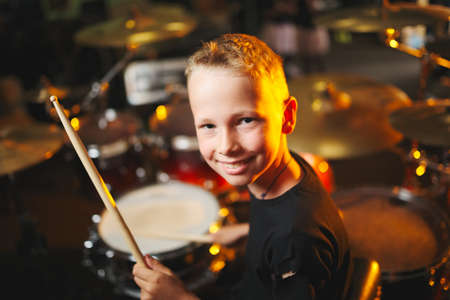 Photo for boy plays drums in recording studio - Royalty Free Image