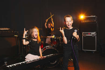 Photo for children singing and playing music - Royalty Free Image