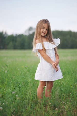 Foto de happy little girl with long hair - Imagen libre de derechos