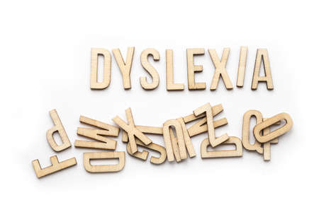 Foto de Aspergers spelled out with wood letters on white background - Imagen libre de derechos
