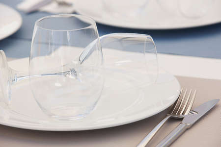 Tableware with dishes and cups detail in a restaurant. Horizontal