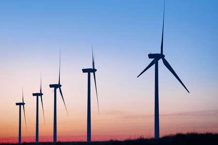 Photo pour Wind mill farm at dusk. Global warming. Sustainable energy. Power - image libre de droit