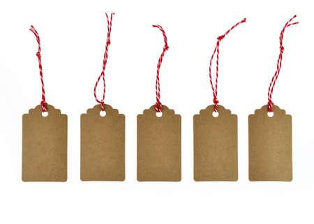 Foto de different little tags as a gift pendant isolated - Imagen libre de derechos