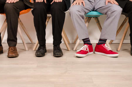 Photo for Four business men waiting for an interview - Royalty Free Image