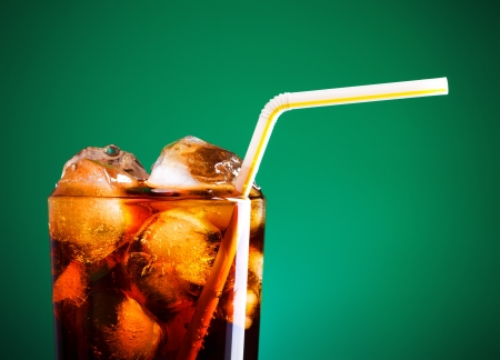 Photo for glass of cola with ice and straw on green background - Royalty Free Image