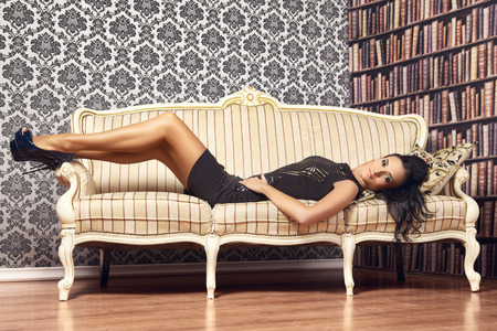 young provocative woman on couch at home