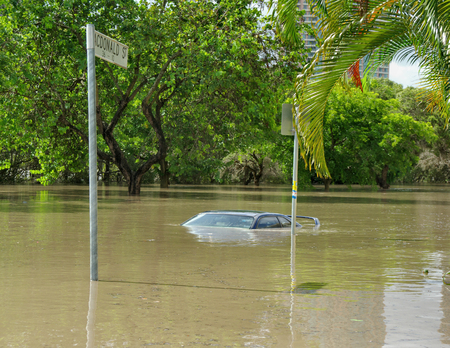 Photo for The 2010-11 Brisbane floods caused a lot of damage. Here a car is submerged in deep floodwater in Kangaroo Point, Brisbane - Royalty Free Image