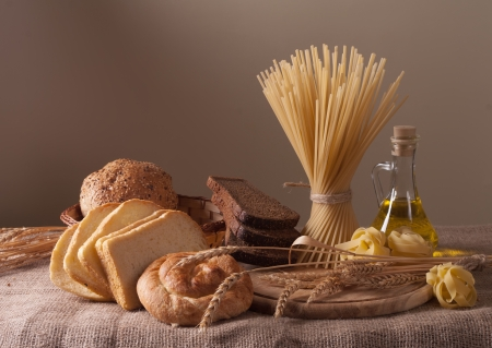 Foto per still life with bread, pasta and wheat - Immagine Royalty Free