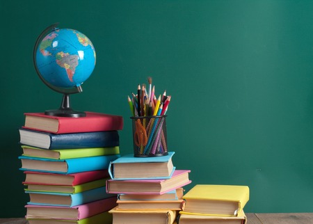 Photo for Books on the background of the school board - Royalty Free Image