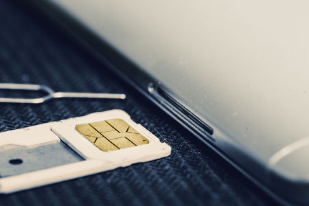 Photo for Open Tray of Micro Sim Card Beside Smartphone. Concept of Change or Swapping To New Sim Card - Royalty Free Image