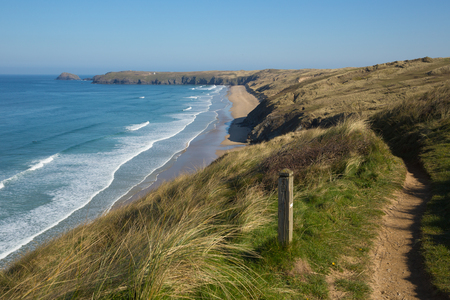 Foto de South west coast path view to Perran sands beach near Perranporth North Cornwall England - Imagen libre de derechos