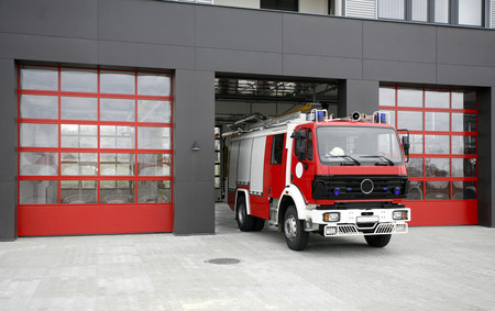 Emergency fire rescue truck. Fire-fighting vehicle on fire-station