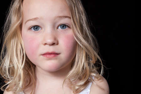 Photo for Close up portrait of a young girl on black background. - Royalty Free Image