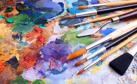 Photo for artists brushes and oilpaints on wooden palette  - Royalty Free Image