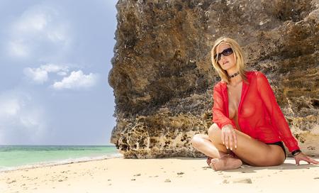 A bikini model posing in an outdoor environment