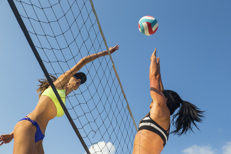 Photo for Two female athletes playing beach volleyball - Royalty Free Image