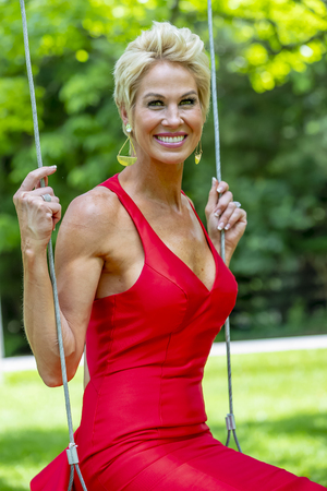 Photo for A beautiful mature blonde model posing in an outdoor environment - Royalty Free Image