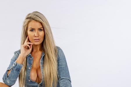 Photo pour A gorgeous blonde lingerie model posing in a studio environment - image libre de droit
