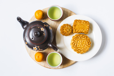 Photo pour Moon cake and tea for Chinese mid autumn festival. Isolated on white. Copy space - image libre de droit