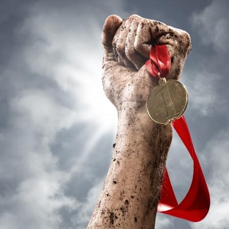 Foto de hand holding a winner s medal, success in competitions - Imagen libre de derechos