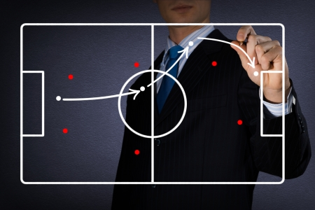 Foto de image of coach draws a diagram of a football game - Imagen libre de derechos