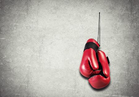 Foto de Boxing gloves hanging nailed to wall as concept of retirement - Imagen libre de derechos