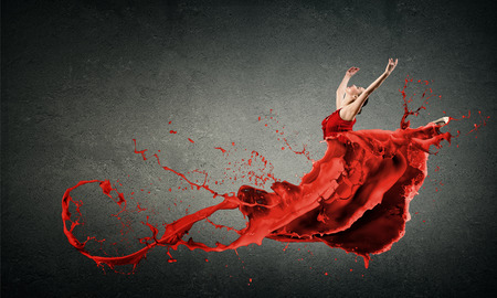 Photo pour Passionate woman dancer in red dress and red spalshes - image libre de droit