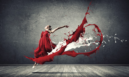 Foto de Passionate woman dancer in red dress and red spalshes - Imagen libre de derechos